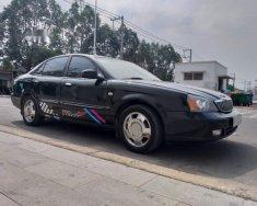 Bán ô tô Daewoo Magnus đời 2004, màu đen giá 128 triệu tại Bình Dương
