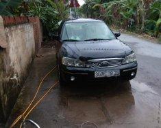 Bán lại xe Ford Laser 1.8 Ghia sản xuất 2003, màu đen số sàn, giá 180tr giá 180 triệu tại Hà Nội
