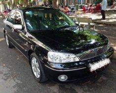 Bán xe Ford Laser Ghi 1.8 2011, màu đen, xe gia đình   giá 186 triệu tại Hà Nội