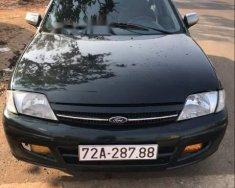 Cần bán gấp Ford Laser 2001, màu đen, xe gia đình, 125tr giá 125 triệu tại Bình Phước