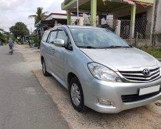 Gia đình cần bán 1 xe Innova đời 2010, màu bạc giá 348 triệu tại Tp.HCM