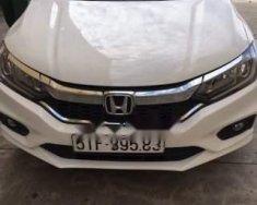 Cần bán lại xe Honda City đời 2018, màu trắng giá cạnh tranh giá 550 triệu tại Tp.HCM