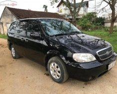 Cần bán xe Kia Carnival GS 2.5 AT năm sản xuất 2009, màu đen, nhập khẩu  giá 220 triệu tại Hà Nội