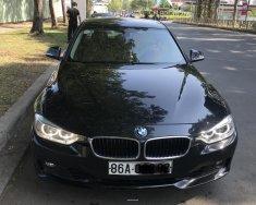 Bán BMW 320i đời 2014, màu đen, xe nhập giá 795 triệu tại Tp.HCM