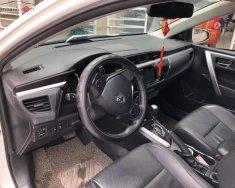 Chính chủ bán lại xe Toyota Corolla altis 1.8G AT đời 2014, màu trắng giá 650 triệu tại Hà Nội