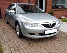 Cần bán xe Mazda 6 số sàn, đời 2004, ĐK 2005, màu bạc giá 293 triệu tại Tp.HCM