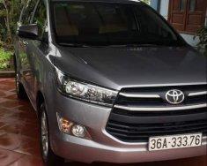 Cần bán lại xe Toyota Innova năm sản xuất 2018, màu xám, giá tốt giá 750 triệu tại Thanh Hóa