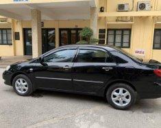 Bán xe Corolla Altis đời 2005 màu đen, số sàn, xe công chức sử dụng đi rất ít và giữ gìn giá 310 triệu tại Hà Nội