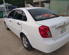 Cần bán Chevrolet Lacetti MT 2012, màu trắng, xe nhập, dàn đồng zin 100% giá 215 triệu tại Bình Dương
