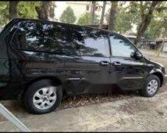 Bán ô tô Kia Carnival đời 2009, màu đen, xe nhập, số tự động giá cạnh tranh giá 290 triệu tại Tp.HCM