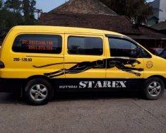 Xe Hyundai Grand Starex MT sản xuất năm 2004, màu vàng giá 225 triệu tại Hà Nội