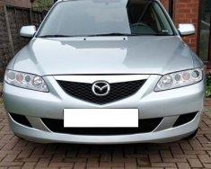 Cần bán xe Mazda 6 số sàn, đời 2004, ĐK 2005 màu bạc giá 262 triệu tại Tp.HCM