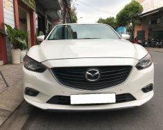 Gia đình cần bán Mazda6 sản xuất 2016, số tự động, bản 2.0, màu trắng giá 696 triệu tại Tp.HCM