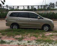 Cần bán xe Toyota Innova 2.0E SX 2014, lăn bánh 2015 màu cát giá 495 triệu tại Tp.HCM