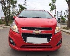 Gia đình bán Chevrolet Spark LTZ 2014 màu đỏ rất mới giá 235 triệu tại Tp.HCM