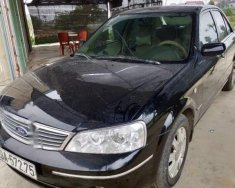 Cần bán xe Ford Laser Ghia sản xuất năm 2004, màu đen giá 180 triệu tại Vĩnh Phúc