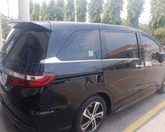 Cần bán lại xe Honda Odyssey sản xuất năm 2016, màu đen giá 1 tỷ 615 tr tại Tp.HCM