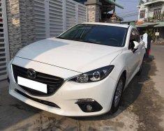 Cần bán xe Mazda 3 model 2016 số tự động màu trắng, giá 566 triệu tại Tp.HCM