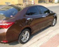 Cần bán xe Toyota Corolla altis năm sản xuất 2014, màu nâu xe gia đình giá 625 triệu tại Tp.HCM