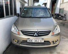 Cần bán lại xe Mitsubishi Zinger GLS 2.4 AT năm sản xuất 2009, màu vàng   giá 359 triệu tại Hà Tĩnh