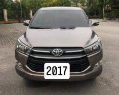 Bán xe Innova E MT số sàn, đời 2017, màu nâu đồng, biển tỉnh giá 680 triệu tại Hà Nội