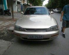 Bán Toyota Camry sản xuất năm 1995, màu vàng, nhập khẩu giá 110 triệu tại Hà Nội