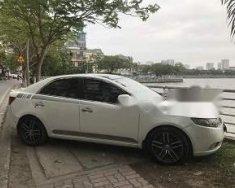 Cần bán xe Kia Cerato 1.6 số tự động, xe nhập khẩu màu trắng, xe đời 2010, đăng ký lần đầu 2011 giá 385 triệu tại Hà Nội