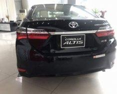 Bán xe Toyota Corolla altis năm 2018, màu đen, giá tốt giá 750 triệu tại Tp.HCM
