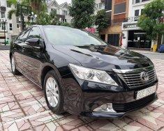 Bán ô tô Toyota Camry 2.0E đời 2014, màu đen giá cạnh tranh giá 738 triệu tại Hà Nội
