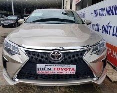 Cần bán xe Toyota Camry 2.5Q đời 2014, màu vàng, 880 triệu giá 880 triệu tại Tp.HCM