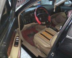 Gia đình bán xe Daewoo Magnus 2004, màu đen, xe nhập giá 172 triệu tại Đồng Tháp
