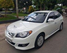 Bán Hyundai Avante 1.6MT sản xuất 2011, màu trắng, gia đình sử dụng kỹ mới 95% giá 318 triệu tại Tp.HCM