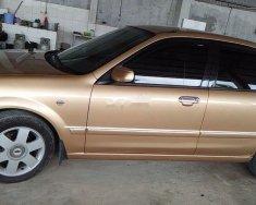 Chính chủ bán Ford Laser năm sản xuất 2003, màu vàng, xe nhập giá 163 triệu tại Tp.HCM