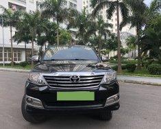 Cần bán Toyota Fortuner 2.7V đời 2015, màu đen, số tự động giá 680 triệu tại Hà Nội