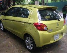 Cần bán lại xe Mitsubishi Mirage 1.2 AT đời 2014, màu vàng, xe nhập còn mới giá 360 triệu tại Hà Nội