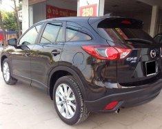 Chính chủ bán Mazda CX 5 2.0AT sản xuất năm 2015, màu đen giá 700 triệu tại Tp.HCM