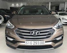 Cần bán xe Hyundai Santa Fe năm 2017, màu nâu xe gia đình  giá 950 triệu tại Tp.HCM