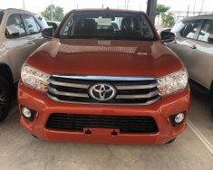 Bán Toyota Hilux 2.4E (4x2) số sàn, màu trắng, bạc, màu cam giao ngay - Khuyến mãi tốt giá 622 triệu tại Tp.HCM