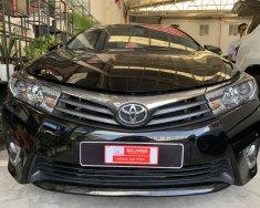 Bán xe Toyota Corolla altis V sản xuất 2014, màu đen, số tự động giá 690 triệu tại Tp.HCM