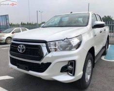 Bán Toyota Hilux 2.4E 4x2 AT năm sản xuất 2019, màu trắng, xe nhập giá 652 triệu tại Hà Nội