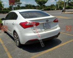 Gia đình bán Kia K3 sản xuất năm 2013, màu trắng giá 390 triệu tại Tp.HCM