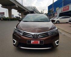 Bán xe Altis 1,8 số sàn SX 2015 màu nâu, giá còn giảm, xe chất khừ giá 595 triệu tại Tp.HCM