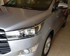 Cần bán lại xe Toyota Innova 2.0E 2016, màu bạc số sàn, giá tốt giá 620 triệu tại An Giang