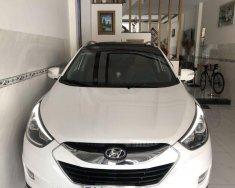 Cần bán gấp Hyundai Tucson 2014, màu trắng, xe nhập khẩu chính hãng giá 599 triệu tại Tp.HCM