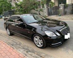 Bán Mercedes E250 CGI sản xuất 2011, màu đen, xe nhập số tự động giá 750 triệu tại Tp.HCM
