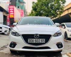 Cần bán gấp Mazda 3 1.5 AT năm sản xuất 2015, màu trắng giá 546 triệu tại Hà Nội