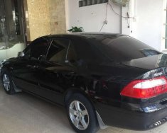 Bán xe cũ Mazda 626 2.0 MT năm 2003, màu đen giá 199 triệu tại Tiền Giang