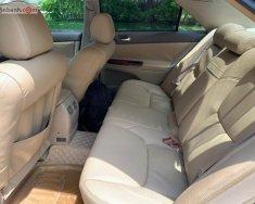 Bán Toyota Camry 3.0V đời 2004, màu đen số tự động giá 320 triệu tại Tp.HCM