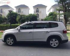 Cần bán gấp Chevrolet Orlando LT 1.8 MT sản xuất năm 2012, màu bạc giá 338 triệu tại Tp.HCM