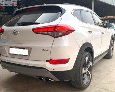 Cần bán xe Hyundai Tucson 1.6 Turbo năm sản xuất 2018, màu trắng như mới giá 868 triệu tại Tp.HCM